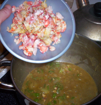 Adding the crawfish meat to the stew matrix, which is an amazing yellowish-orangish color thanks to the crawfish fat
