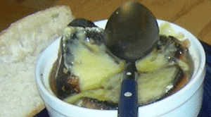 French onion soup, and the spoon with which I hope to conquer it.